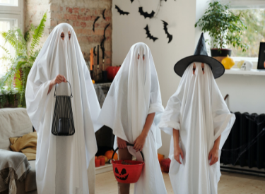 kids are celebrating halloween using costume