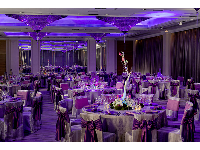 hotel ballroom with decorated dining tables and chairs