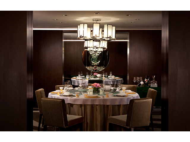 private dining room using round table and chandelier