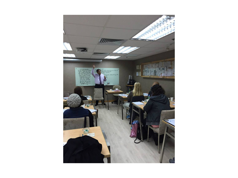 training session using classroom setup with whiteboard and projector