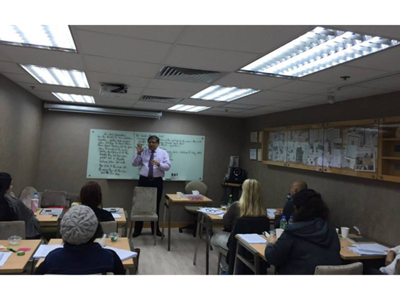 trainer is giving the material to his class attendees