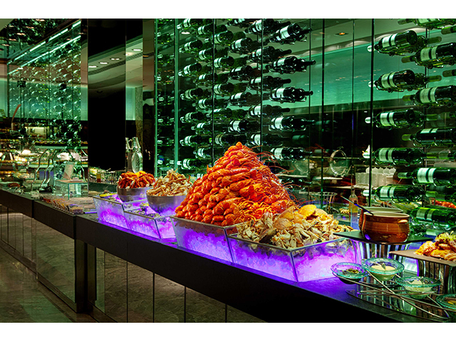 buffet line table with the view of wine bottles
