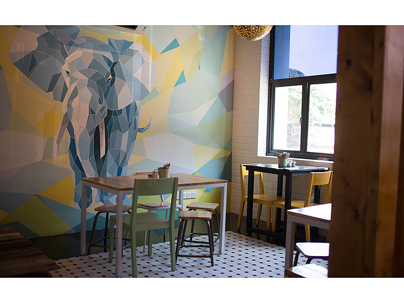 cozy vibe cafe with elephant graffiti and natural light