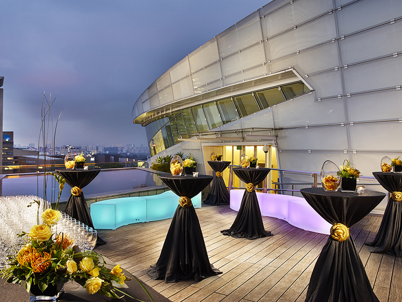 outdoor city view venue in singapore with several cocktail tables