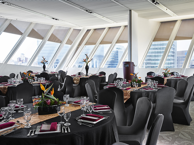 indoor event space in singapore with black banquet seating