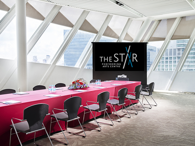 singapore workshop event space with large windows and big screen