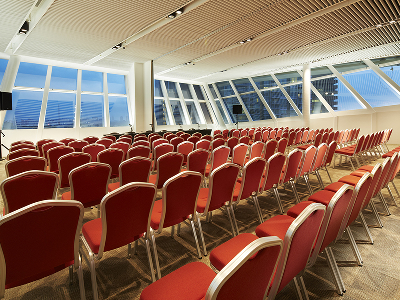 theatre seating venue in singapore with red audience chairs