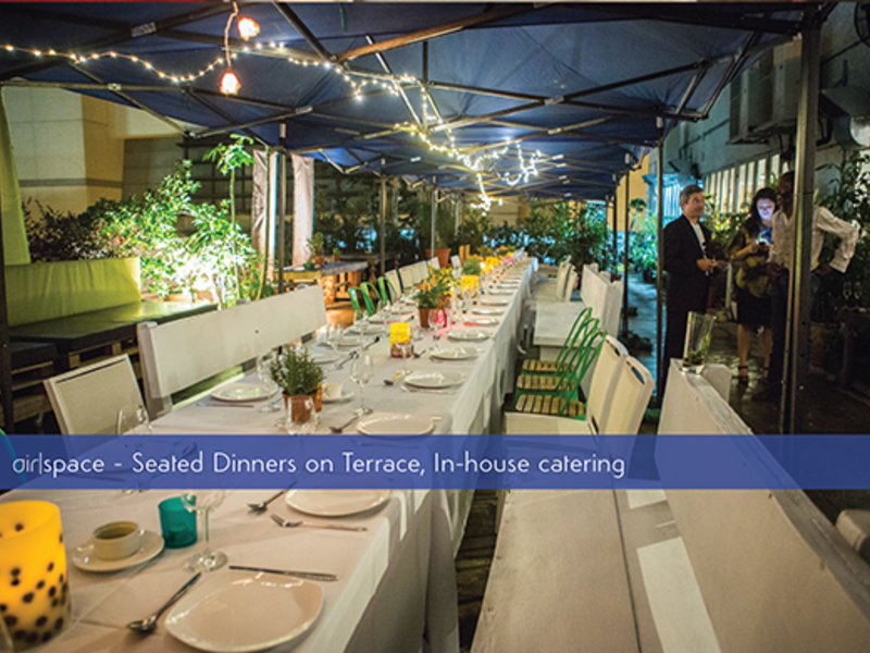 seated dinner on terrace with in house catering