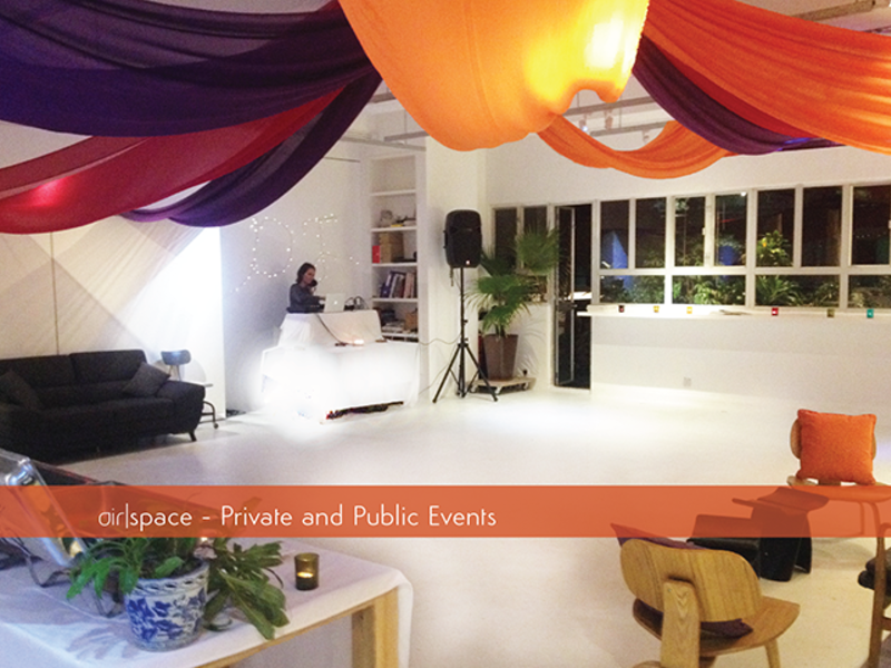 private and public event area with colourful fabric on the ceiling