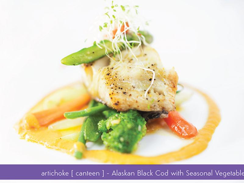 alaskan black cod with seasonal vegetables served on the plate