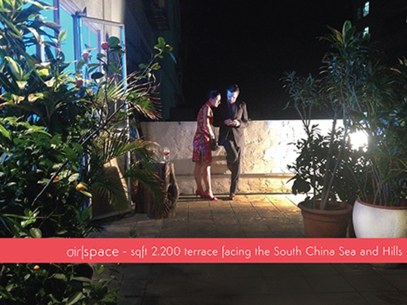 man and woman are talking at the outdoor area facing the south china sea and hills