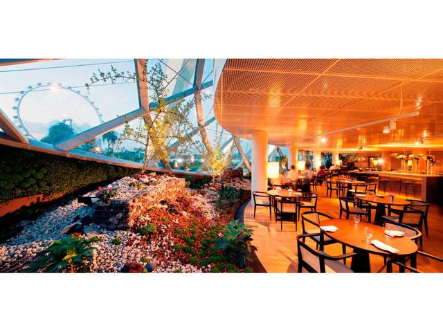 restaurant with indoor garden with singapore ferris wheel views