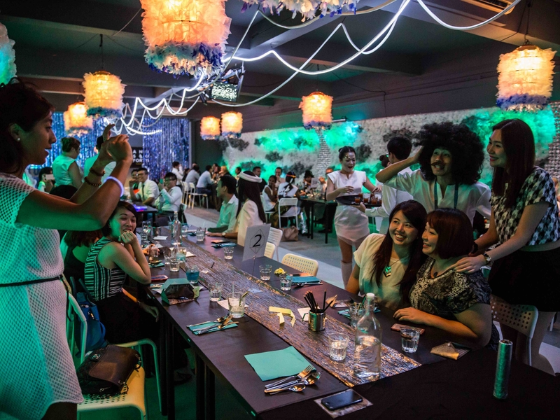 people taking photos during their private white theme party