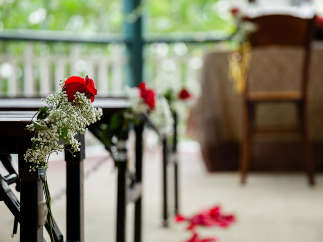 wedding decoration on the chair using red rose