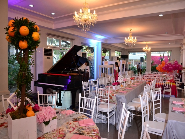 private wedding party at the function hall featuring the grand piano and white pink decoration