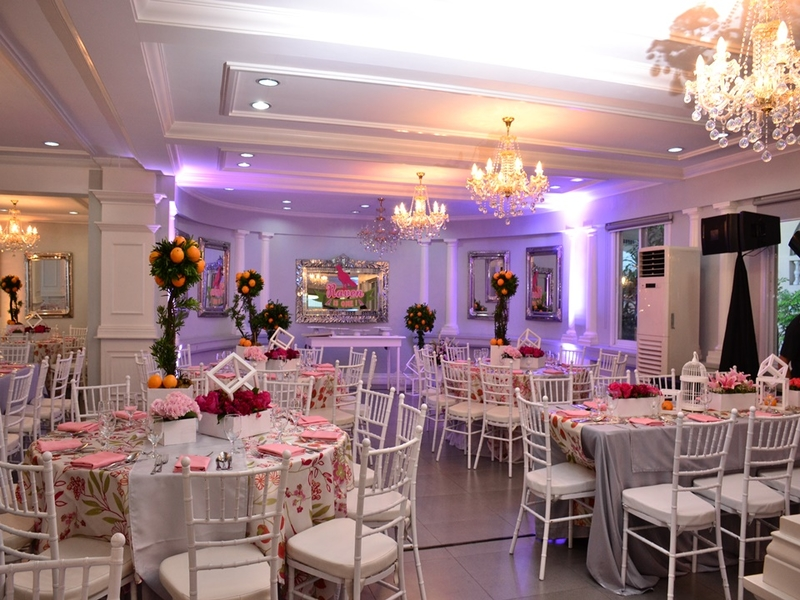 multifunctional event space with wedding setup and crystal chandelier