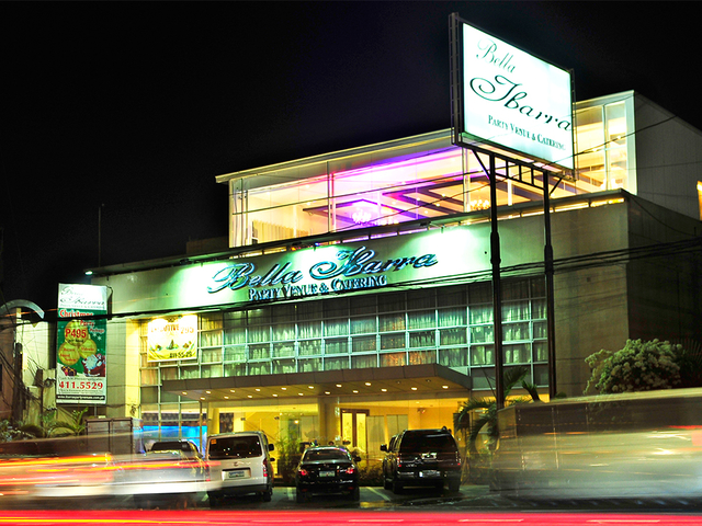 the exterior building of bella ibarra at night