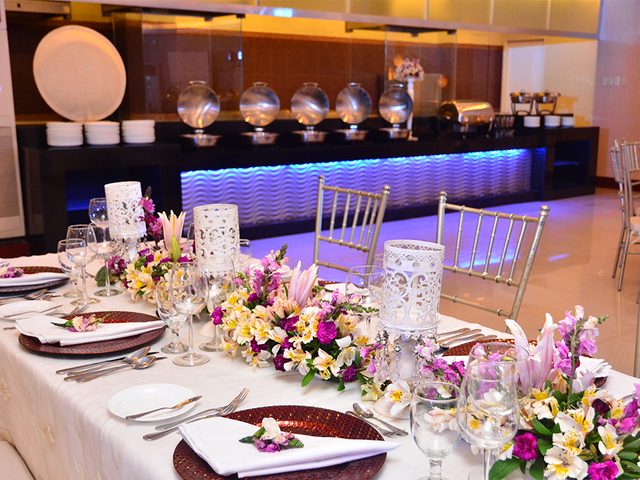 intimate wedding dinner with long table setup and flower table decorations