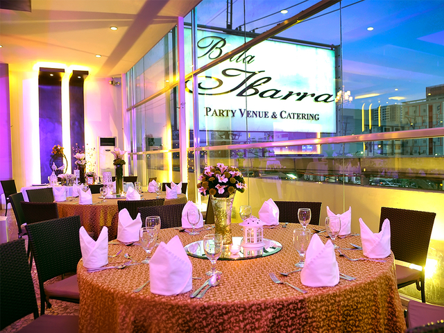 function room with banquet style with the view of the city