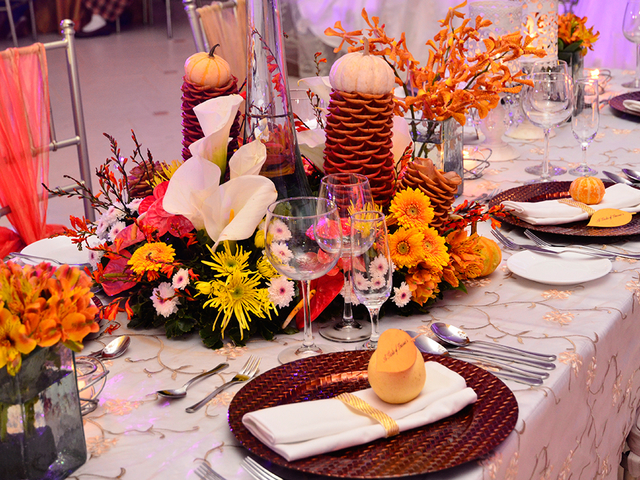 dining utensils and flower centrepiece in wedding reception