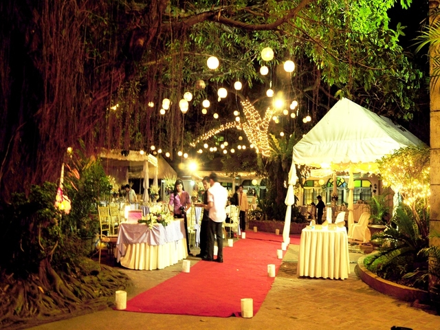 outdoor wedding aisle in between table and buffet station tent