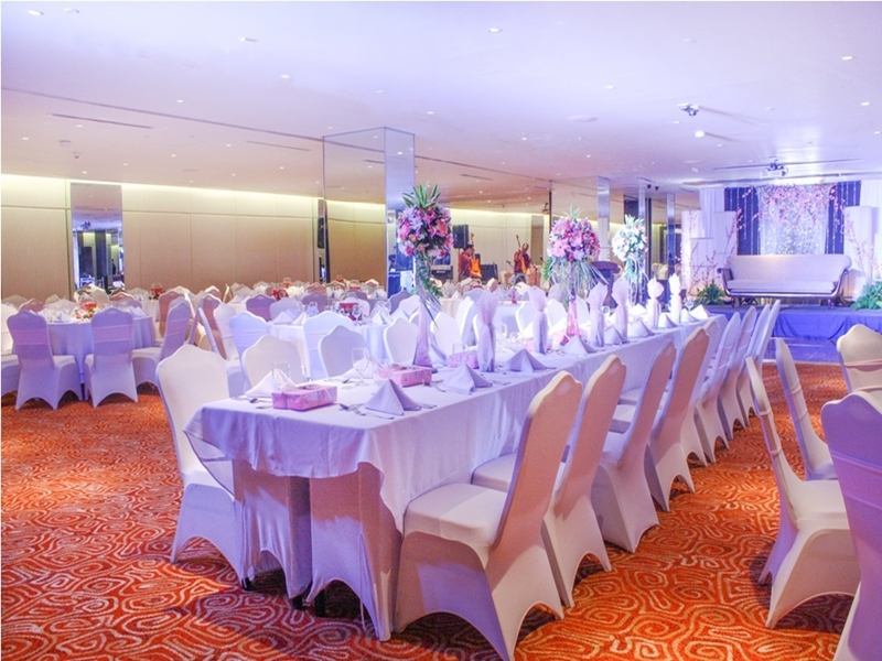 philippines indoor year-end party space with white long dining table and flower decorations