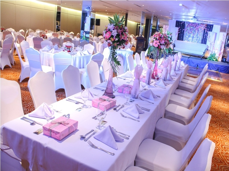 white long tables with flower decorations in manila birthday venue