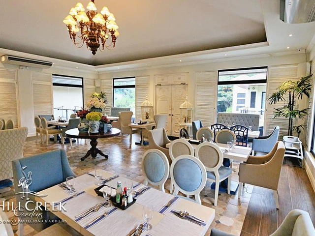 restaurant area decorated with gleaming chandelier