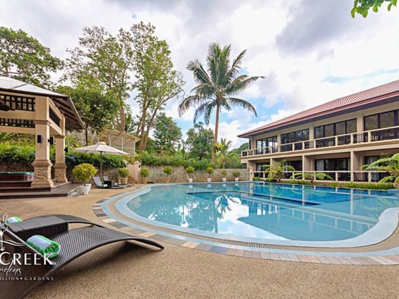 outdoor swimming pool surrounded with nature and function hall building