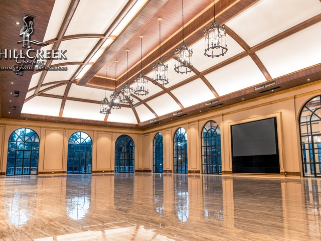 function room with floor to ceiling window and high ceiling