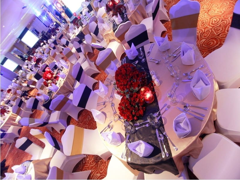 christmas party space in manila with beige banquette seating and high ceiling