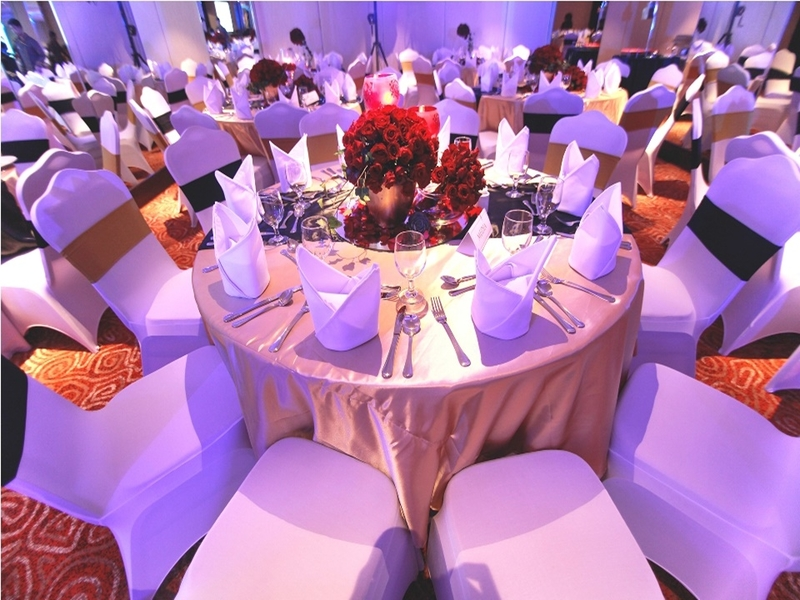 corporate dinner and dance venue in manila with round tables set up and flower decorations