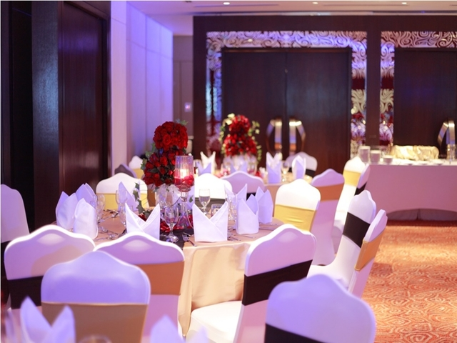 philippines corporate dining venue with round tables and flower decorations