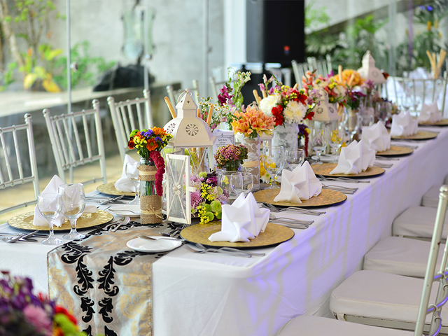 birthday party space in tagaytay with long white  table and flower decorations
