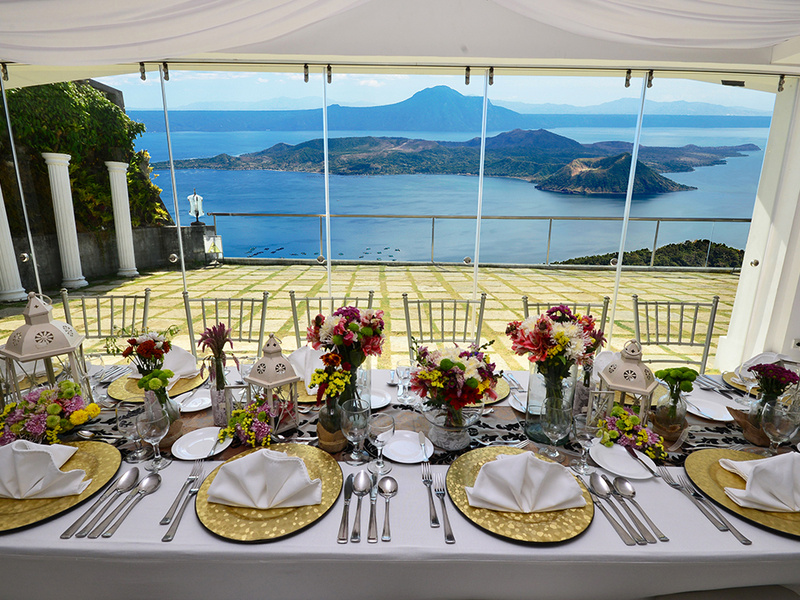 tagaytay event space with long white dining table and sea view