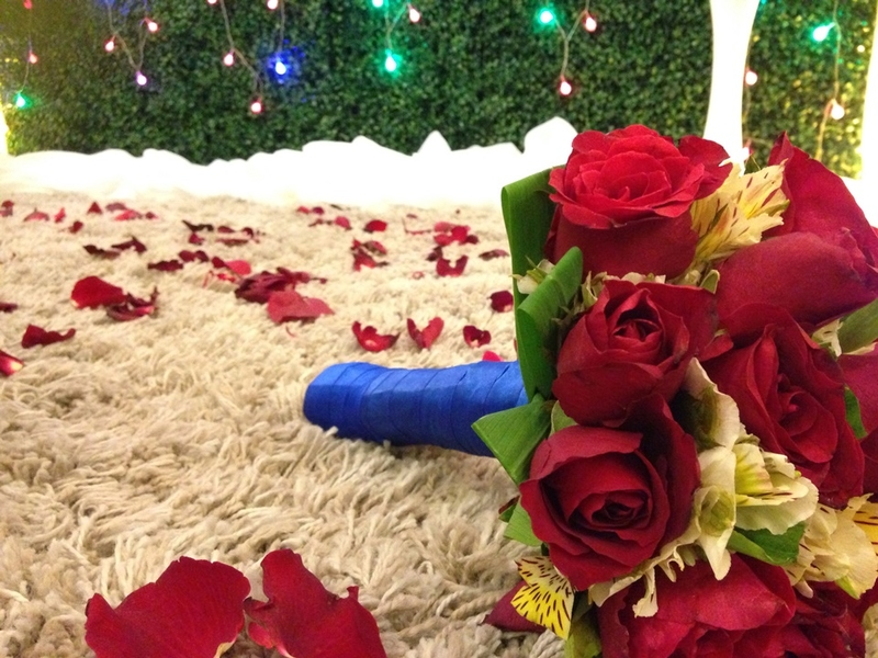 flower bouquet with rose petals on ground