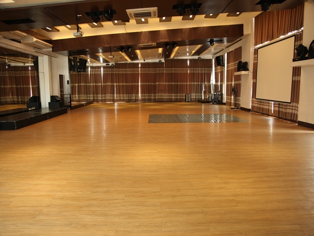 venue with wooden floor and brown curtains