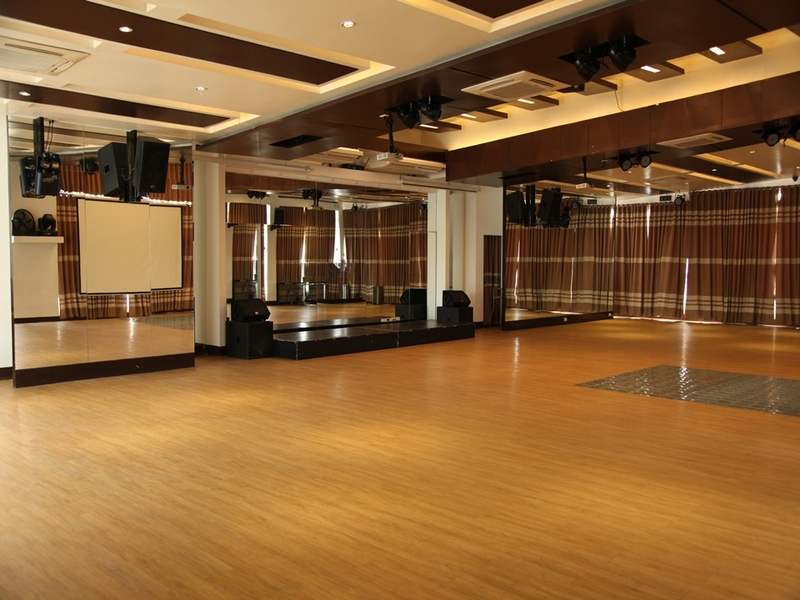 event space equipped with giant screen, stage, and audio facilities