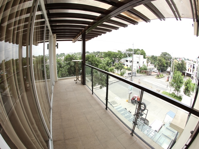 the rooftop terrace area with the outside view