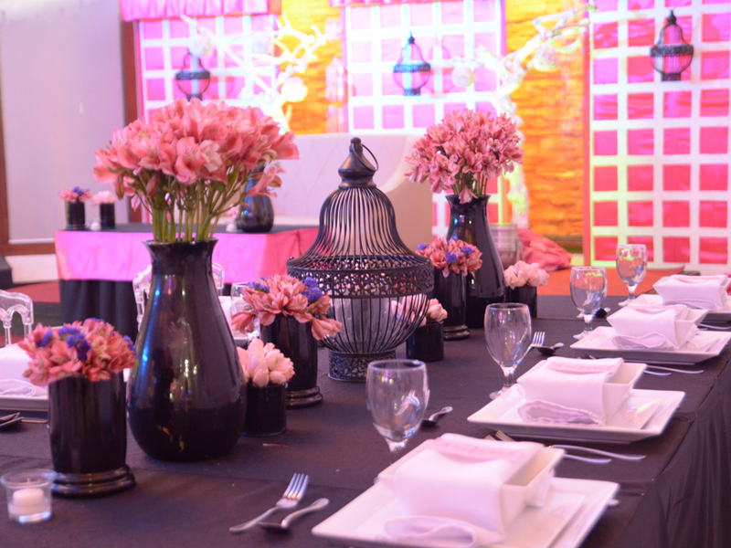corporate dining event venue in pasay with long black table and flowers decoration