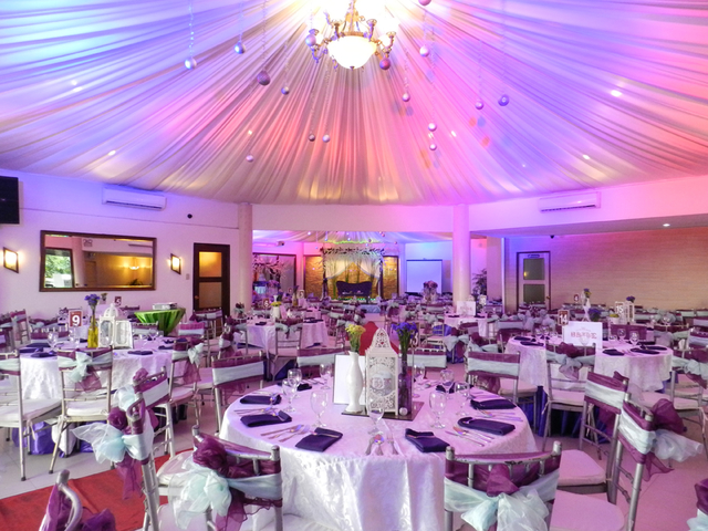 big white event venue in pasay with banquet seating and pendant lamps