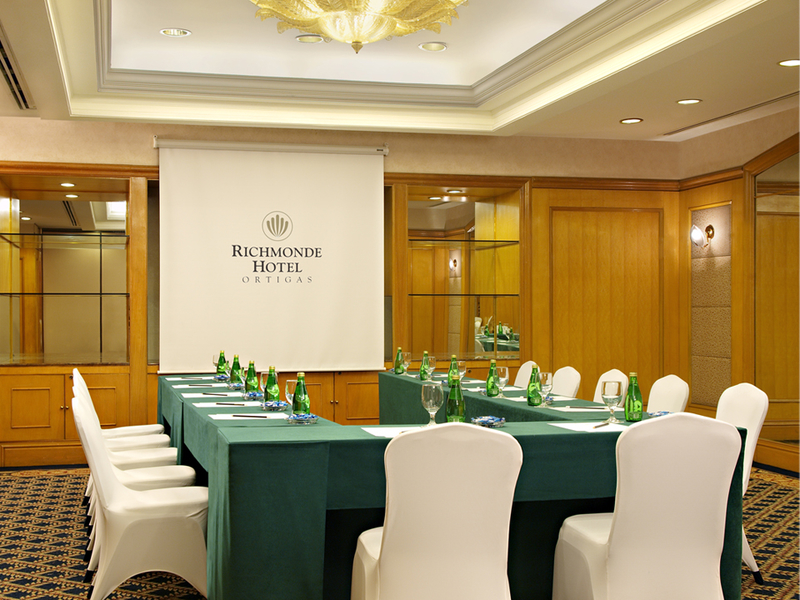 formal board meeting room with projector screen