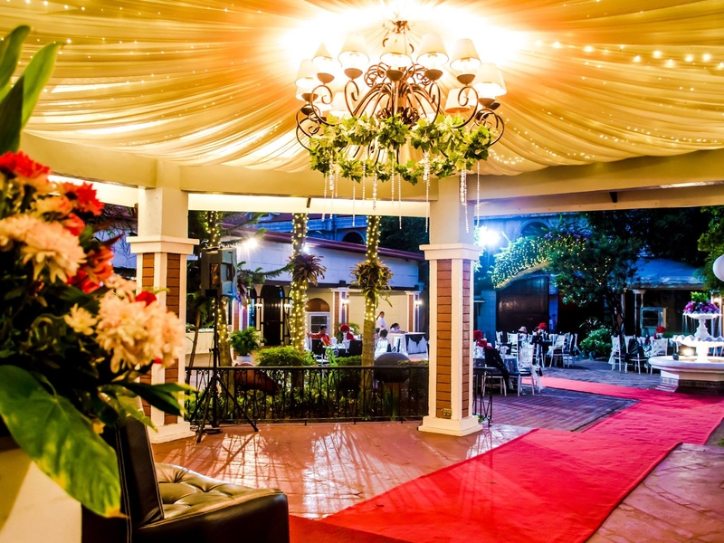 red carpet leading to the entrance of wedding space