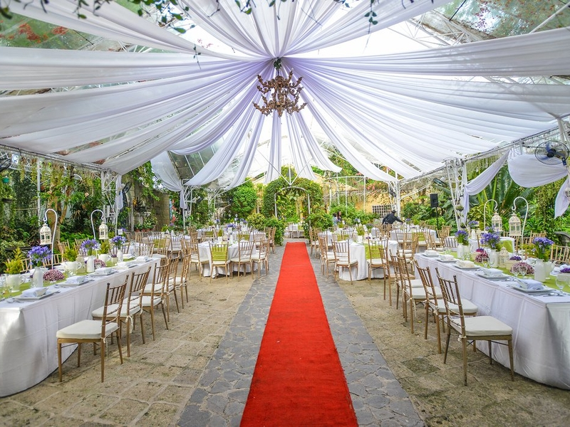 unique outdoor garden wedding venue with red carpet to the stage