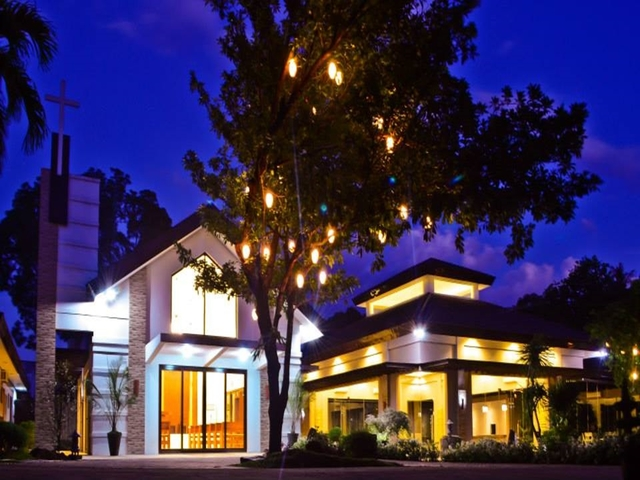 the exterior building of hidden grove events place at night