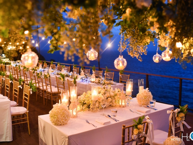 outdoor intimate wedding party surrounded with sea view and nature