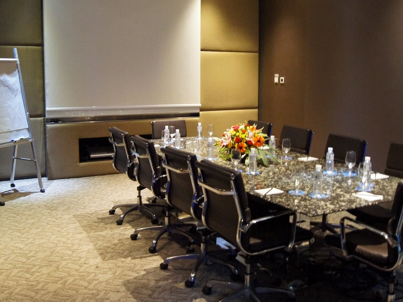 private meeting room equipped with giant screen and standing flipchart