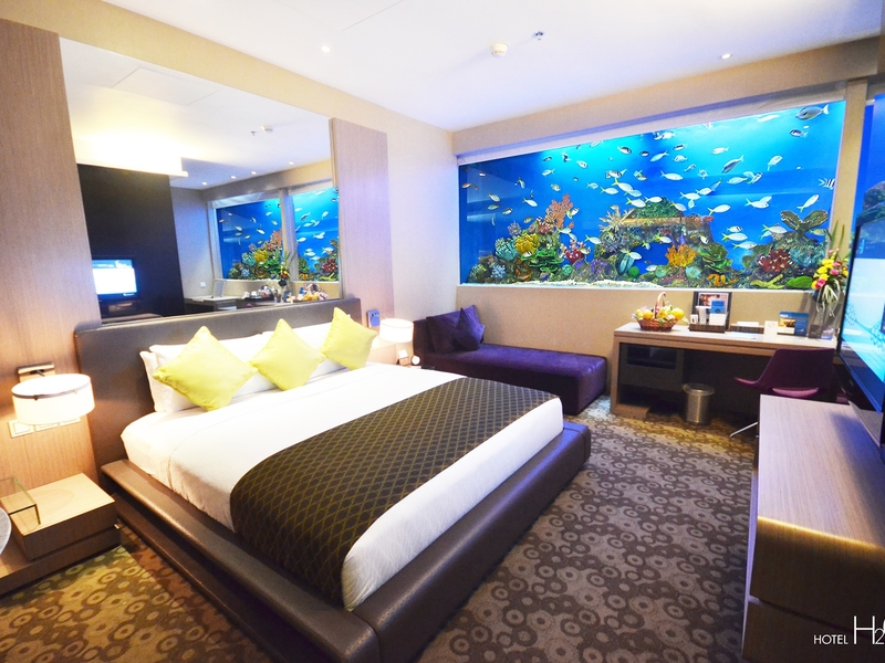 hotel bedroom with aquarium wall
