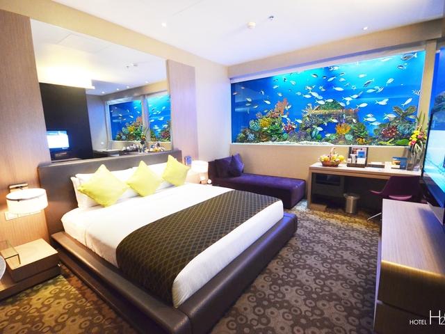 hotel bedroom with aquarium wall