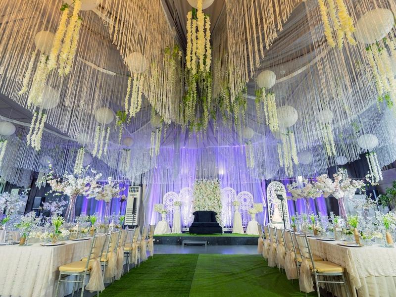 wedding ballroom with ceiling draping and long table setup